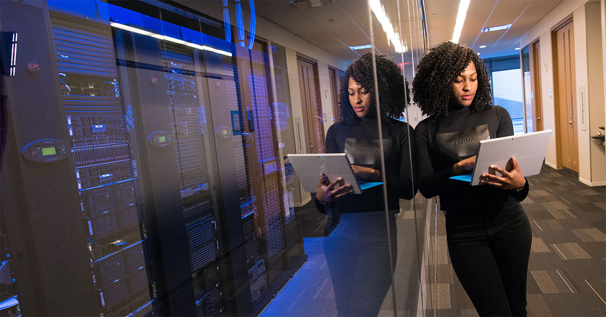 Lady leaning against glass protecting website servers